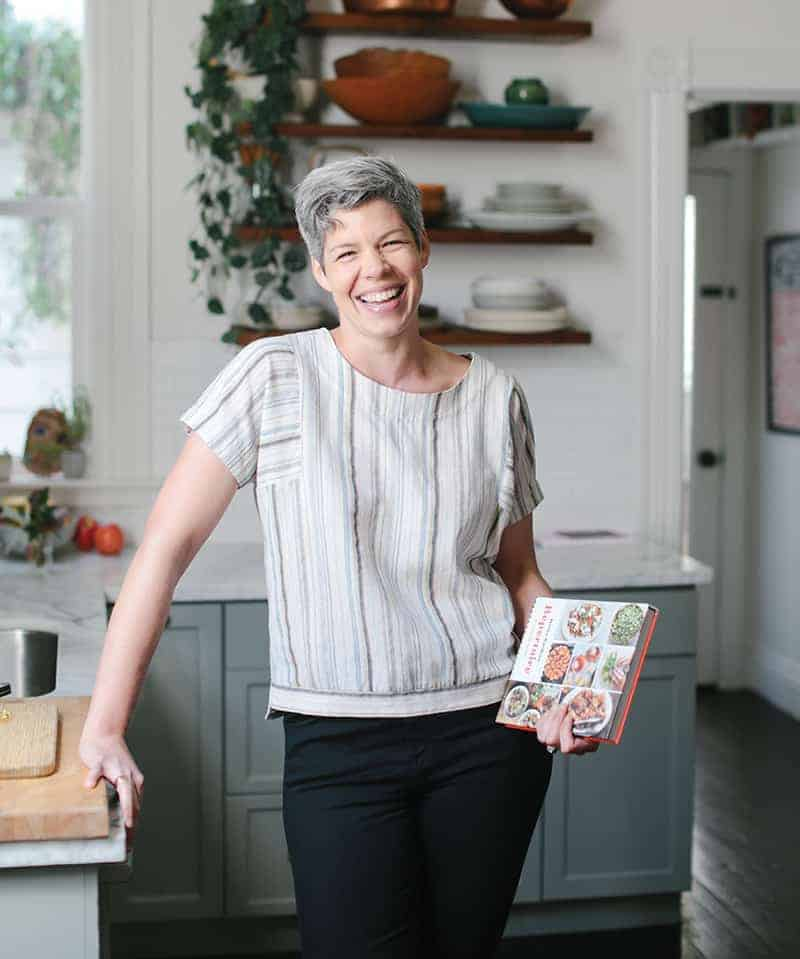 jessica battilana in her kitchen with her book repertoire