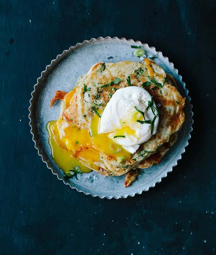 poached egg with savory cauliflower pancakes