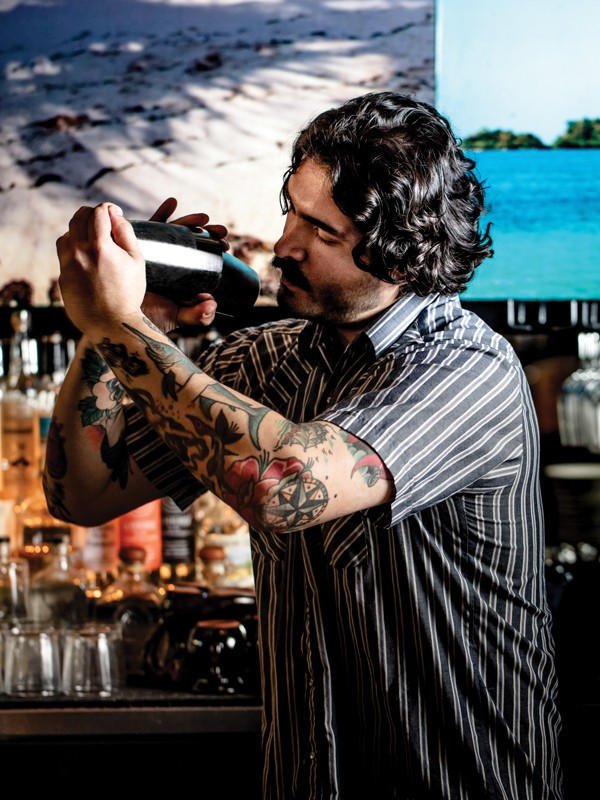 leon vasquez of lolo shaking a cocktail