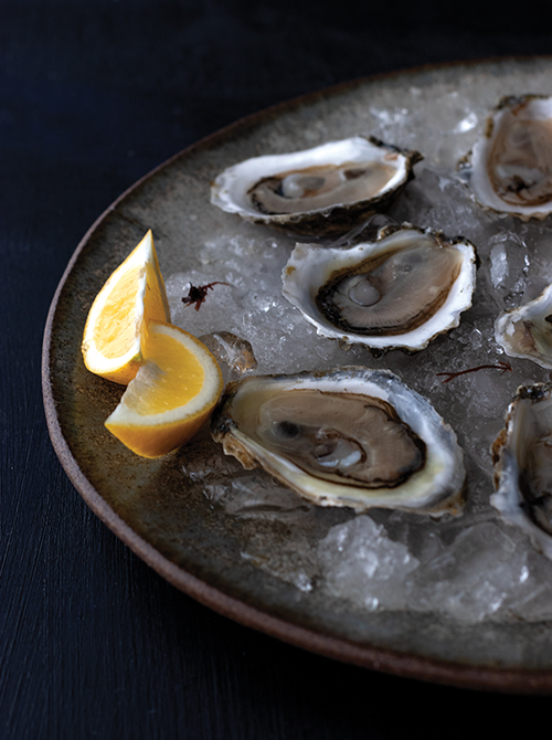 eat local plate of oysters