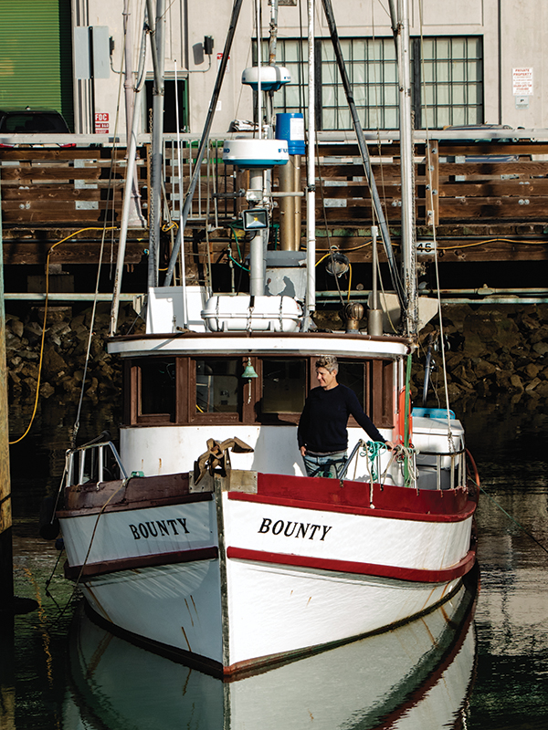 sarah bates on her boat, the Bounty